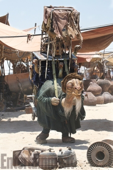 "One of the first creatures revealed as part of the new Star Wars menagerie was this desert merchant known as Bobbajo. The human performer shares only his legs with the alien, and the rest of his body extends up into the various cages being hauled on Bobbajo's back. (The actor can see through the mouth of the large amphibian-like creature in the middle cage.) ""He was envisaged as this sort of seller who would lumber his way to the market every day, selling these rather weird and strange creatures, which he had in the cages,"" says Neal Scanlan, who headed the film's creature shop. ""He's very slow, he's very laid back."" Judging by the drowsy look in his eyes, you wonder if Bobbajo may be hustling some herbal products, too."