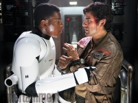 We knew Poe Dameron ended up in the clutches of The First Order, and here he appears to be pretty roughed up. Whether he sustained these bloody injuries during his capture or they're the result of Kylo Ren's interrogation is still unclear. What this image reveals is that Dameron and Finn do meet before Boyega's character goes AWOL. All this does is raise more questions about why Finn ends up wearing Poe's clothes on Jakku — and how the X-Wing pilot goes from handcuffed prisoner to his return to the Resistance base.
